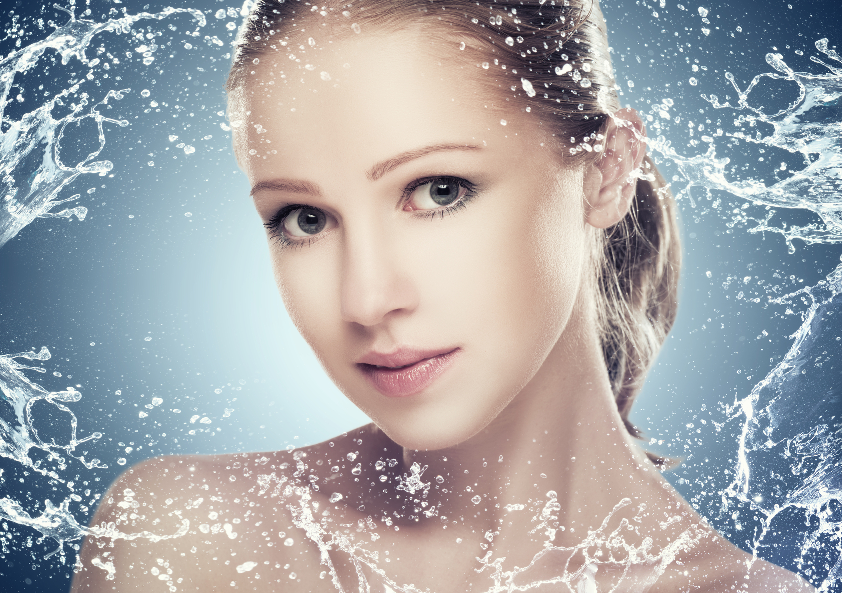 concept beauty skin care, face of beautiful girl with splashes and  water